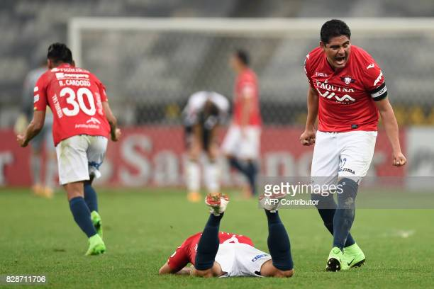 Brazilian Serginho of Bolivia's Jorge Wilstermann celebrates with a temmate after his team qualified in the end of a Copa Libertadores football match...
