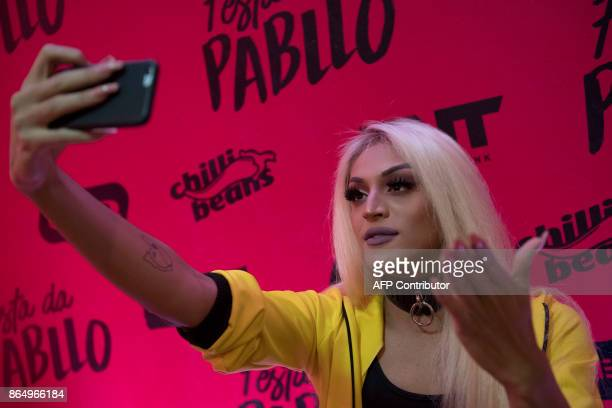Brazilian singer and drag queen Pabllo Vittar talk with fans via instagram during a press conference at the Vivo Rio in Rio de Janeiro Brazil on...