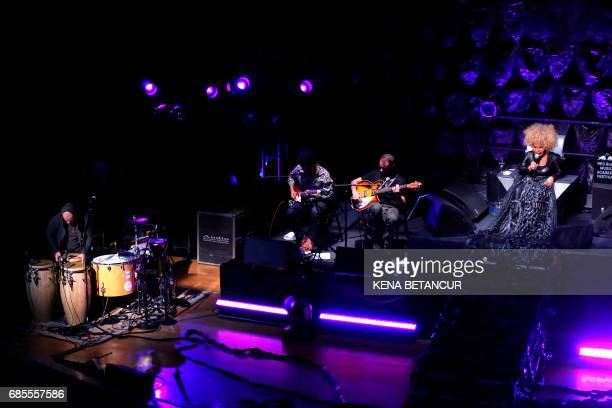 Brazilian singer Elza Soares performs at the Town Hall theater on May 19 2017 in New York / AFP PHOTO / KENA BETANCUR / With AFP Story by Laura...