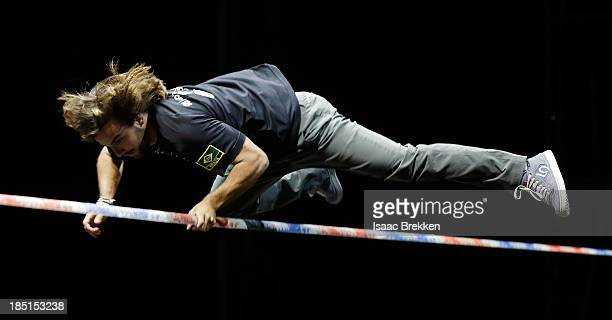 Brazilian slackline athlete Carlos 'Na Fita' Neto performs during the Slackline World Cup at Mandalay Bay Resort and Casino on October 17 2013 in Las...