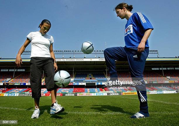 Brazilian socccer player Marta Vieira da Silva of Swedish team Umea IK plays 07 May 2004 with a ball toghether with German Birgit Prinz of Frankfurt...