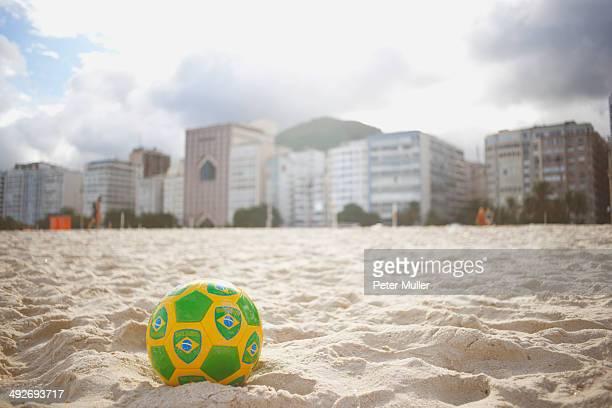 Brazilian soccer ball on Copacabana beach, Rio De Janeiro, Brazil