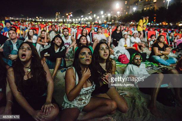 Brazilian soccer fans watching 2014 FIFA World Cup Brazil Third Place Playoff match between Brazil and the Netherlands in the Fifa Fan Fest in...