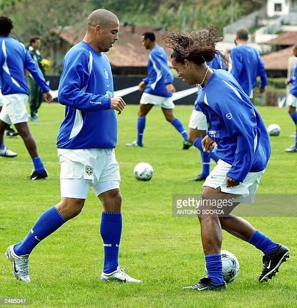 Brazilian soccer forwards Ronaldo Nazario and Ronaldinho Gaucho struggle for the ball 05 September 2003 after the training session at Granja Comary...