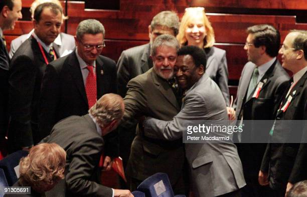Brazilian soccer legend Pele hugs Brazilian President Luiz Inacio Lula da Silva as King Juan Carlos of Spain looks on during the Opening Ceremony of...