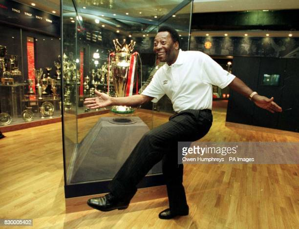 Brazilian soccer legend Pele in a dancing mood during a news conference today in the trophy room at the new Manchester United Football Club Museum...