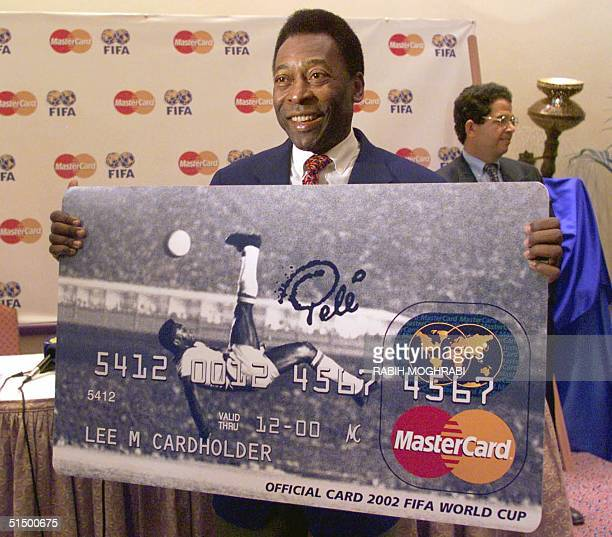 Brazilian soccer legend Pele presents a new MasterCard credit card showing his famous 1965 bicycle kick goal for Brazil against Belgium during his...