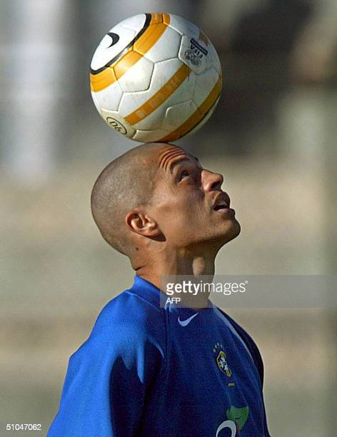 Brazilian soccer midfielder Alexsandro de Souza known as Alex heads the ball 10 July 2004 during a training session at Melgar stadium in Arequipa...