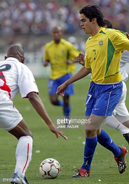 Brazilian soccer player Kaka tries to elude Peruvian John Galliquio 16 November 2003 during the South American qualifying round match for the FIFA...
