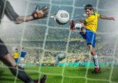 Brazilian Soccer player kicking ball at goal