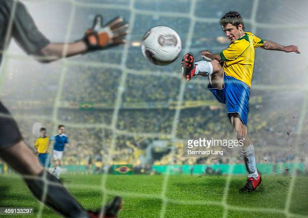 Brazilian Soccer player kicking ball at goal
