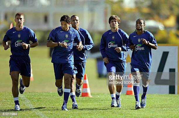Brazilian soccer players Marcelo Bordon Alexandro de Souza Luis Fabiano Diego da Cunha and Vagner Love jog 30 June 2004 during the practice session...