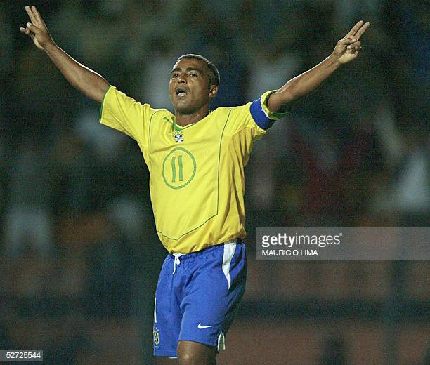 Brazilian soccer star Romario celebrates his goal during a friendly match against Guatemala in his retiring homage 27 April 2005 at Pacaembu stadium...