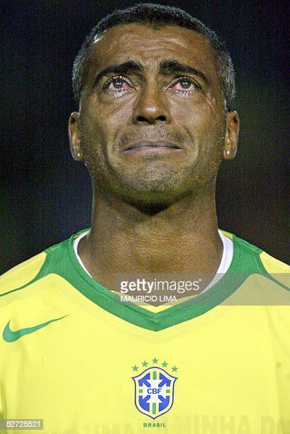 Brazilian soccer star Romario cries as he listens to his national anthem at the beginning of a friendly match against Guatemala for his retiring...