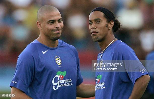Brazilian soccer striker Ronaldo Nazario of Spanish team Real Madrid shares a joke with forward Ronaldinho Gaucho of Spanish Barcelona 11 October...