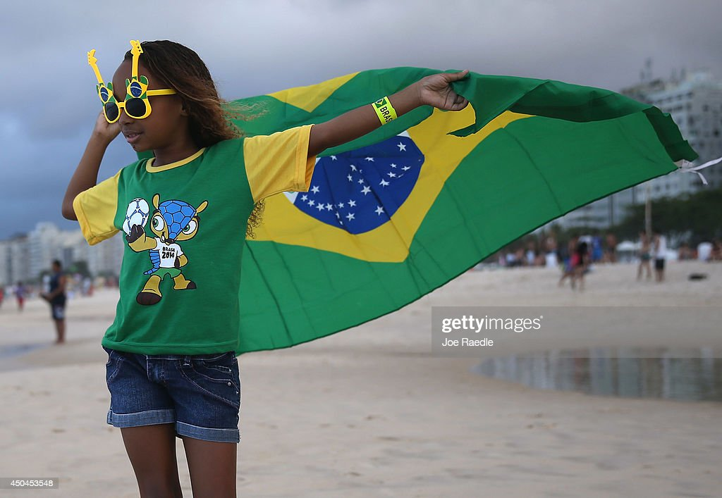 Brazilian soccer team fan, Giovanna Selena, from Brazil, flies her countries flag as she enjoys Copacabana beach while waiting for the start of the 2014 FIFA World Cup on June 11, 2014 in Rio de Janeiro, Brazil. Brazil continues to prepare to host the World Cup which starts on June 12th and runs through July 13th.
