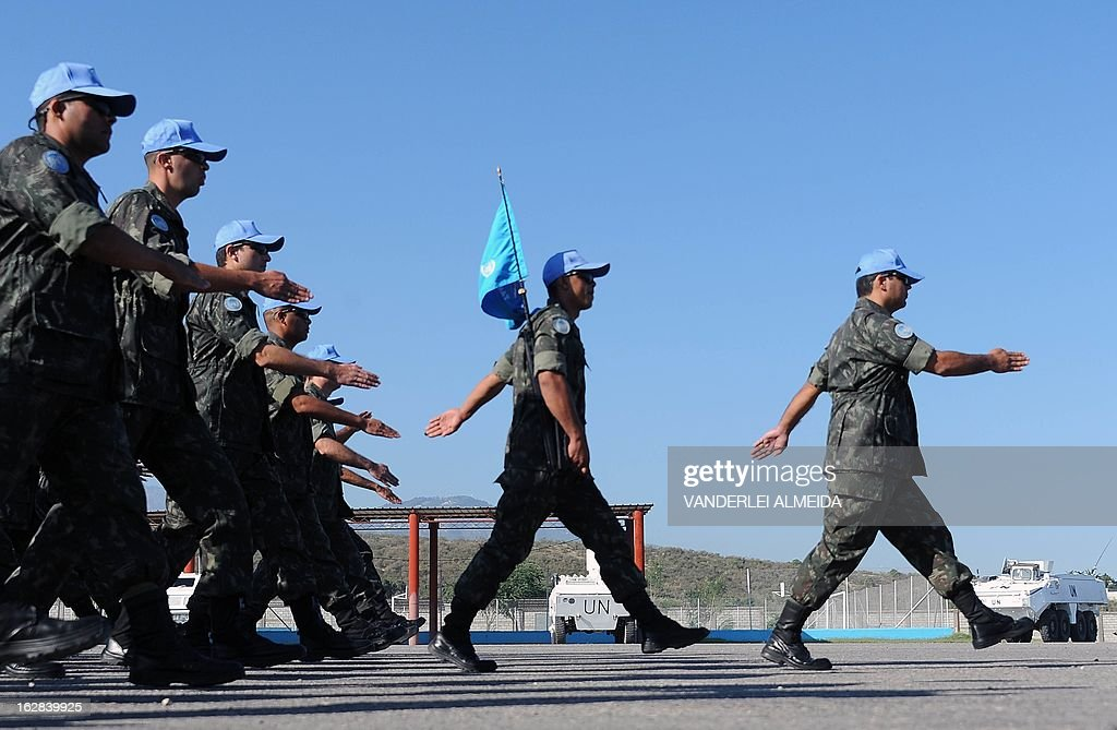Brazilian soldiers parade during a ceremony for the replacement of troops of the MINUSTAH mission at the military base in Port-au-Prince on February 28, 2013. AFP PHOTO/VANDERLEI ALMEIDA