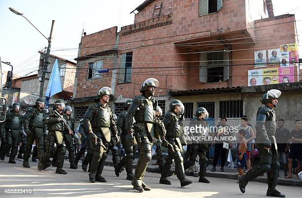 Brazilian soldiers provide security during the visit of Brazil's President Dilma Rousseff candidate of the Workers' Party for October's presidential...