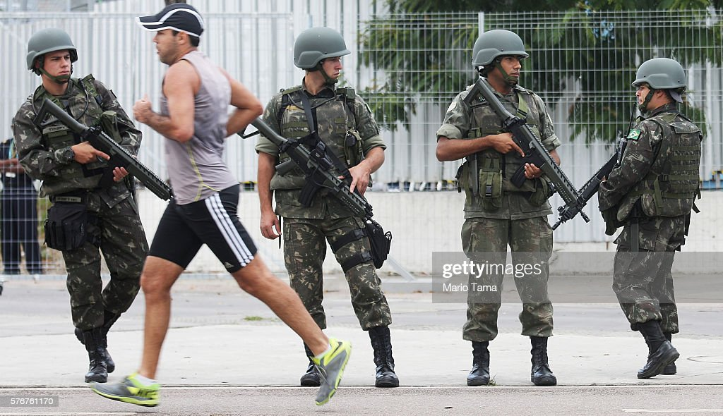 Brazilian soldiers stand on patrol during a security rehearsal of the Rio 2016 Olympic Games opening ceremony outside Maracana stadium on July 17...