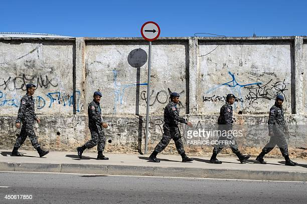 Brazilian soldiers take position in a street next to The Arena Amazonia in Manaus on June 14 ahead of the England v Italy match of the 2014 FIFA...