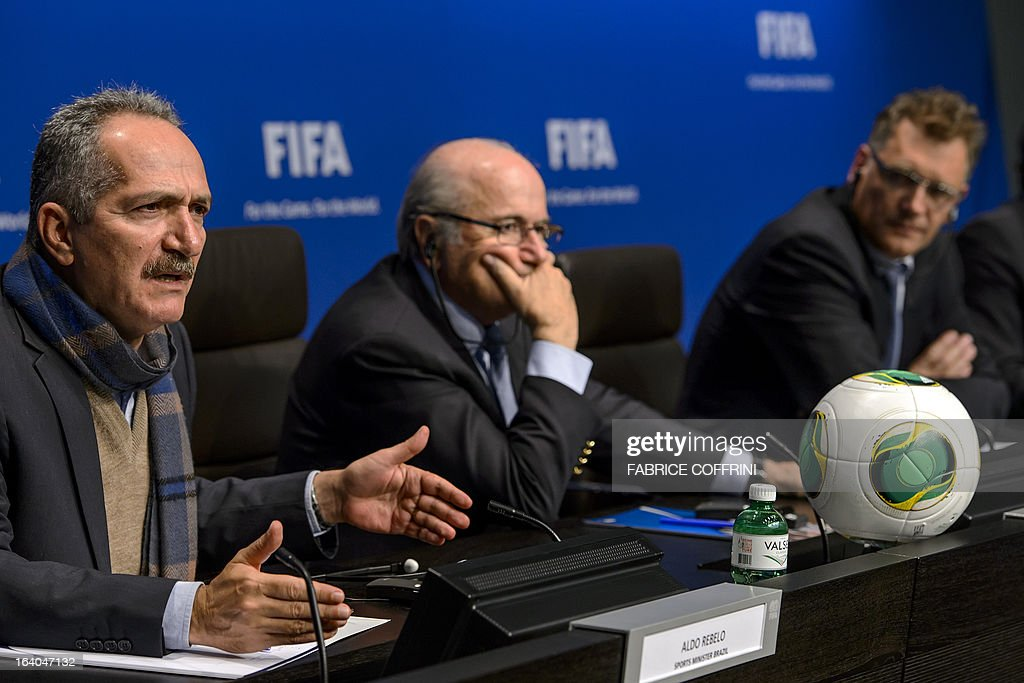Brazilian Sports Minister Aldo Rebelo, FIFA president Joseph Blatter and FIFA secretary general Jerome Valcke attend a press conference following a meeting at the Home of FIFA on March 19, 2013 in Zurich. AFP PHOTO / FABRICE COFFRINI