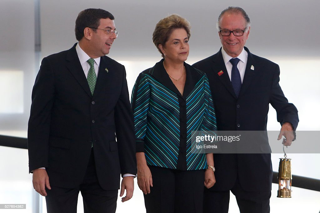 Brazilian Sports Minister Ricardo Leyser, President of Brazil <a gi-track='captionPersonalityLinkClicked' href=/galleries/search?phrase=Dilma+Rousseff&family=editorial&specificpeople=1955968 ng-click='$event.stopPropagation()'>Dilma Rousseff</a> and President of the Brazilian Olympic Committee Carlos Nuzman attend a ceremony where the pyre and the Olympic torch are lit to start the relay at the Planalto Palace on May 3, 2016 in Brasilia, Brazil. The Olympic torch will pass through 329 cities from all states in Brazil before arriving in Rio de Janeiro on August 5, for the lighting of the cauldron.