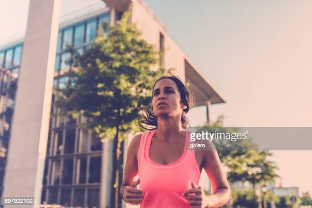 brazilian sportswoman running in city