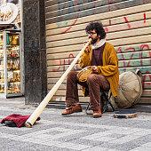 Brazilian street musician in turkey plays caribbean drum and didgeridoo