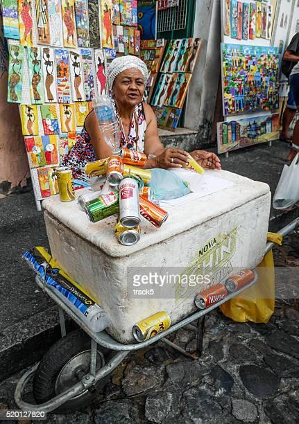 Brazilian street trader selling beer