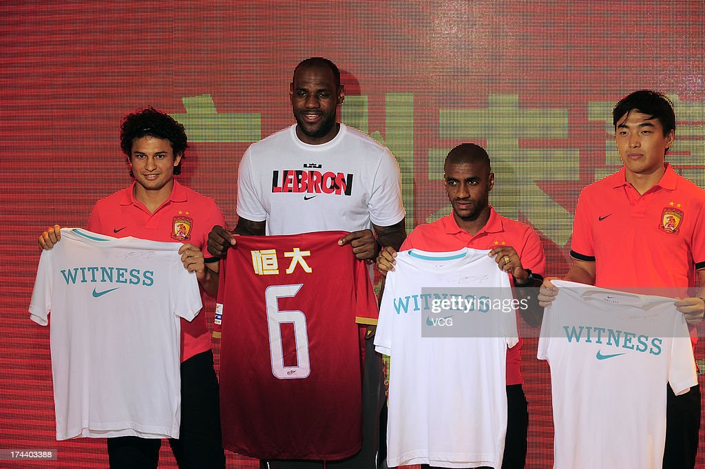 Brazilian striker Elkeson of Guangzhou Evergrande, <a gi-track='captionPersonalityLinkClicked' href=/galleries/search?phrase=LeBron+James&family=editorial&specificpeople=201474 ng-click='$event.stopPropagation()'>LeBron James</a> of the Miami Heat, Brazilian striker Muriqui of Guangzhou Evergrande and Feng Xiaoting of Guangzhou Evergrande pose for photos at a Nike store on July 25, 2013 in Guangzhou, China.