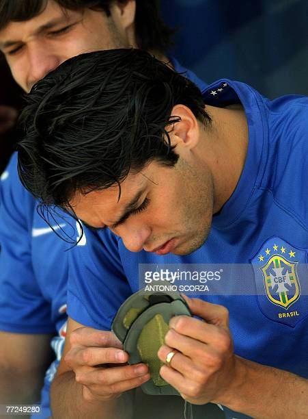 Brazilian striker Kaka checks his boot insoles observed by teammate Diego during a training session in Teresopolis Brazil 10 October 2007 Brazil will...