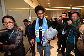 Brazilian striker Luiz Adriano arrives at Nanjing Lukou International Airport on January 18 2016 in Nanjing China Luiz Adriano will sign a contract...