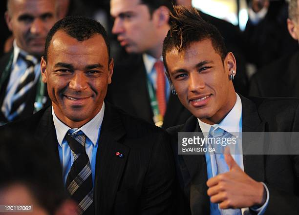 Brazilian striker Neymar gives the thumb up next to Brazilian football star Cafu during the Preliminary Draw for the 2014 FIFA World Cup Brazil on...