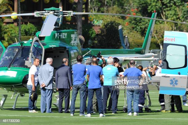 Brazilian striker Neymar is embarked on a stretcher on July 5 2014 into the helicopter that will transport him from Teresopolis Rio de Janeiro State...