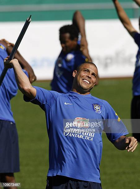 Brazilian striker Ronaldo prepares to throws a mark like a dart 10 June 2006 during a training session at the Zagallo Arena in Konigstein Brazil's...