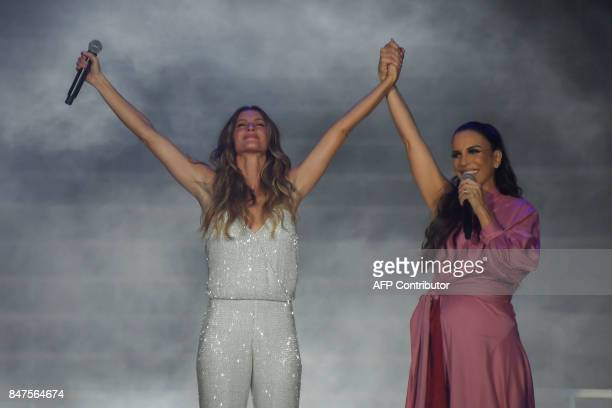 Brazilian super model Gisele Bundchen and Brazilian singer Ivete Sangalo sing John Lennon's 'Imagine' at the World Stage on the first day of 'Rock in...