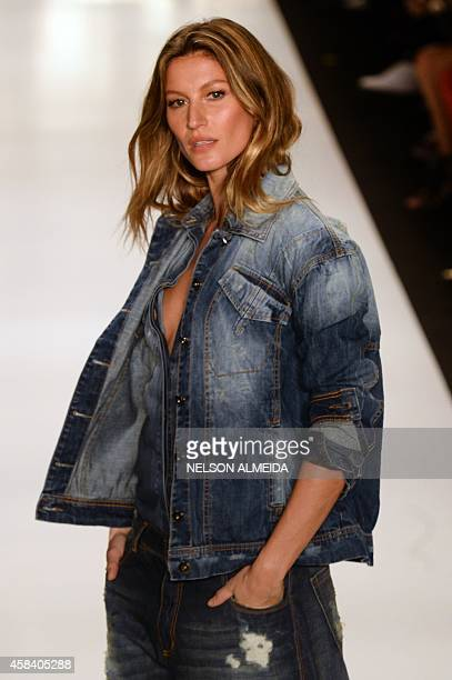 Brazilian supermodel Gisele Bundchen presents a creation by Colcci during the 2015 Winter collection of the Sao Paulo Fashion Week in Sao Paulo...