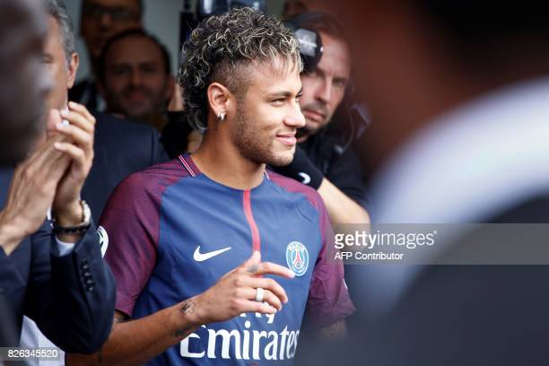 Brazilian superstar Neymar arrives to greet supporters during his official presentation at the Parc des Princes stadium on August 4 2017 in Paris...