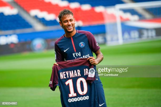 TOPSHOT Brazilian superstar Neymar poses with his new jersey during his official presentation at the Parc des Princes stadium on August 4 2017 in...