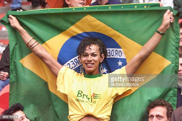 A Brazilian supporter displays a national flag on the stands of Parc des Princes stadium in Paris 27 June before the kickoff of the 1998 Soccer World...