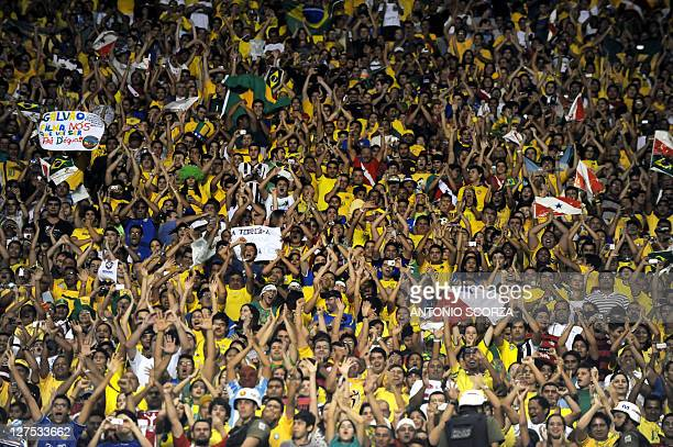 Brazilian supporters cheer during their Americas Super Classic match against Argentina at the Mangueirao stadium on September 28 2011 in Belem Brazil...