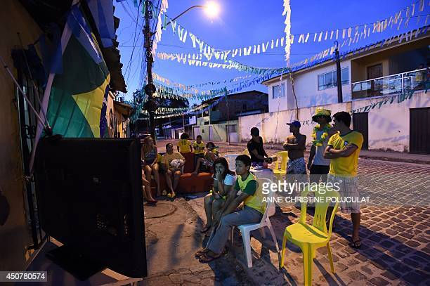 Brazilian supporters react as they watch in Porto Seguro on June 17 2014 the match opposing Brazil to Mexico during the 2014 FIFA World Cup AFP PHOTO...
