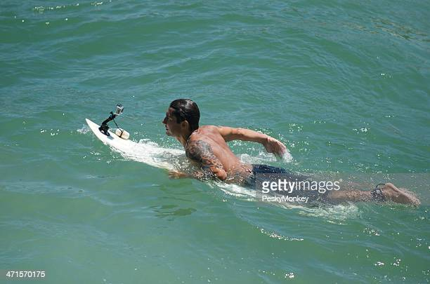 Brazilian Surfer with Video Camera in Rio de Janeiro Brazil