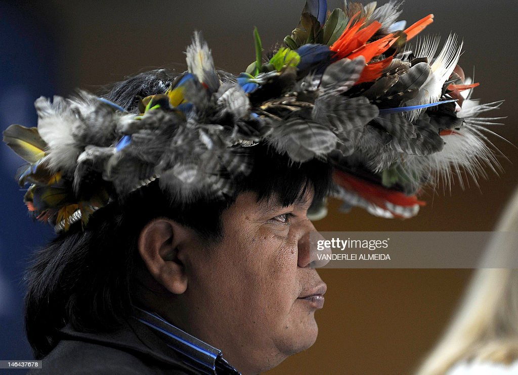 Brazilian Surui tribe Chief Almir is seen during press conference alongside Rebecca Moore (out of frame), Engineering Manager of Google Earth Engine and Earth Outreach, in Rio de Janeiro, Brazil on June 16, 2012. Moore announced the creation of a Google culture map for the Surui tribe in Amazonia. The UN conference, which marks the 20th anniversary of the Earth Summit -- a landmark 1992 gathering that opened the debate on the future of the planet and its resources -- is the largest ever organized, with 50,000 delegates.AFP PHOTO /VANDERLEI ALMEIDA