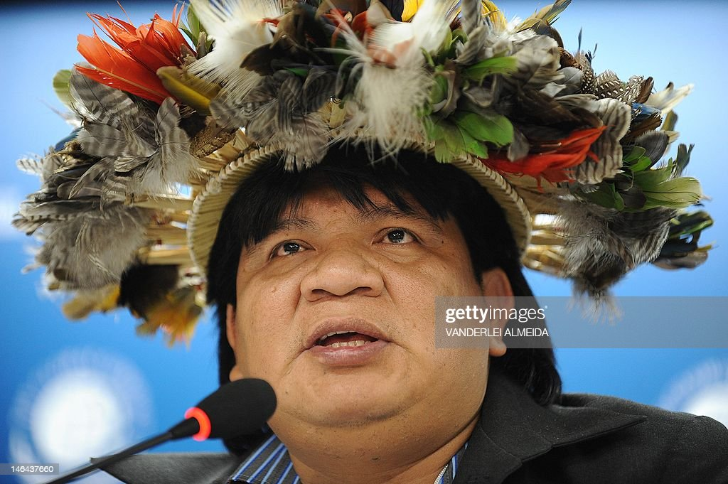 Brazilian Surui tribe Chief Almir speaks alongside Rebecca Moore (out of frame), Engineering Manager of Google Earth Engine and Earth Outreach, during press conference in Rio de Janeiro, Brazil on June 16, 2012. Moore announced the creation of a Google culture map for the Surui tribe in Amazonia. The UN conference, which marks the 20th anniversary of the Earth Summit -- a landmark 1992 gathering that opened the debate on the future of the planet and its resources -- is the largest ever organized, with 50,000 delegates.