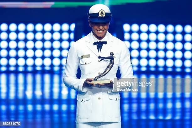Brazilian Swimming competitor Etiene Medeiros is awarded during the ceremony of Brazil Olympics 2016 Awards at Cidade das Artes on March 29 2017 in...