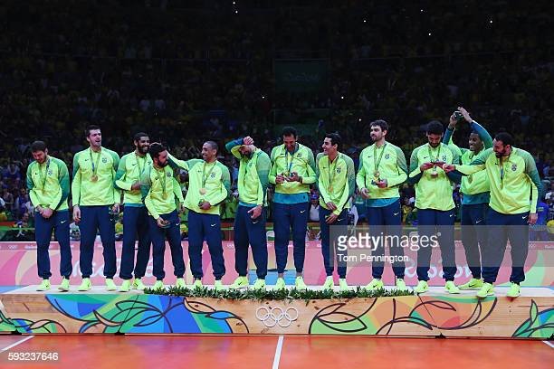 Brazilian team celebrate with their gold medals following the Men's Gold Medal Match between Italy and Brazil on Day 16 of the Rio 2016 Olympic Games...