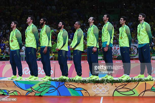 Brazilian team celebrate with their medals following the Men's Gold Medal Match between Italy and Brazil on Day 16 of the Rio 2016 Olympic Games at...