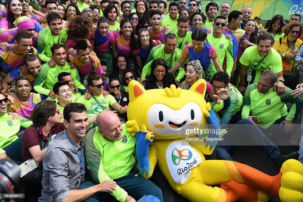 Brazilian team for the 2016 Rio Olympics pose for a group photo in the Athletes Village following their official welcome and flag raising ceremony on...