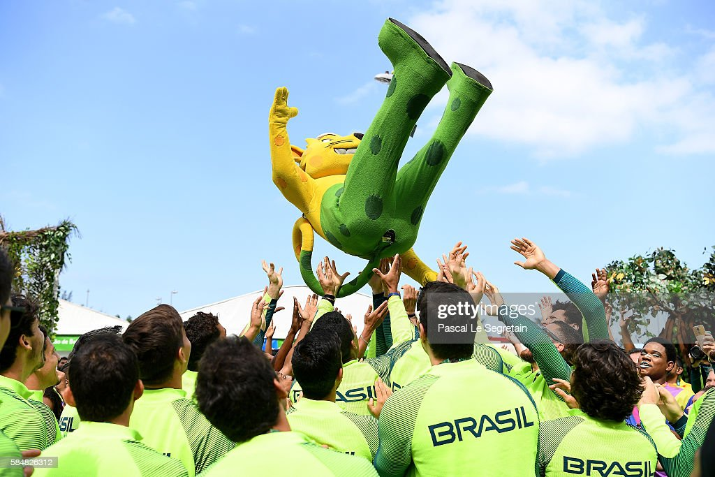 Brazilian team for the 2016 Rio Olympics throw the Rio 2016 mascot in the air in the Athletes Village following their official welcome and flag...